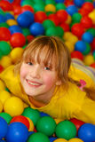 Happy girl in ball pool Stock Photography