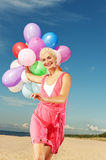 Happy girl with balloons Royalty Free Stock Photography