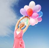 Happy girl with balloons Stock Photo