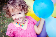 Happy girl with balloons Stock Images