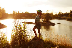 Happy girl on the bank of the river Royalty Free Stock Photos