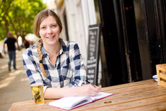 Happy girl at bar Royalty Free Stock Images