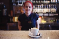 Happy girl Barista gives coffee  to the customers Stock Image
