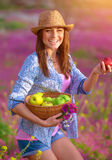 Happy girl with basket of apples Royalty Free Stock Photography