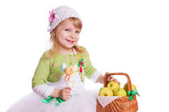 Happy girl with basket of green apples Royalty Free Stock Photo