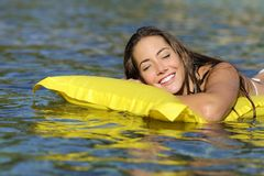 Happy girl bathing on the beach in summer vacation Royalty Free Stock Images