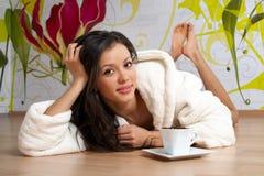 Happy girl in a bathrobe Stock Photos