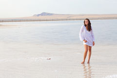 Happy girl on the beach Stock Image