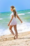 Happy girl on beach Royalty Free Stock Photos