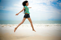 Happy girl at the beach Stock Photography
