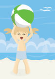 Happy girl on a beach playing with beach ball Royalty Free Stock Images