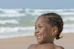 Happy girl at the beach, six years old Royalty Free Stock Photo