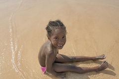 Happy girl at the beach, six years old Stock Photos