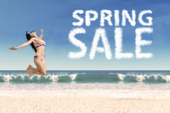 Happy girl at beach with spring sale Stock Image