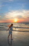 Happy girl on the beach at sunset. Stock Images