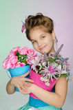 Happy girl with beautiful flowers Royalty Free Stock Photography