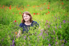 Happy girl in a beautiful meadow Royalty Free Stock Image