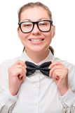 Happy girl with a beautiful smile correcting tie. Around the neck Royalty Free Stock Photo