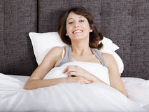 Happy girl in the bed Stock Photography