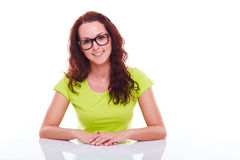 Happy girl behind a table Stock Photography