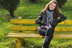 Happy girl on bench Stock Photos