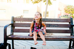 Happy girl on a bench Royalty Free Stock Images