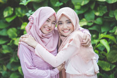 Happy girl best friend together. Portrait of happy group of pretty girl best friends together. muslim women concept wearing hijab or head scarf Stock Photos
