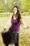 Happy girl on the bicycle Stock Photo