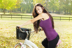 Happy girl on the bicycle Stock Images