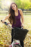 Happy girl on the bicycle Royalty Free Stock Photography