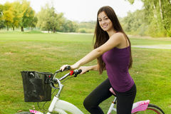 Happy girl on the bicycle Royalty Free Stock Photos