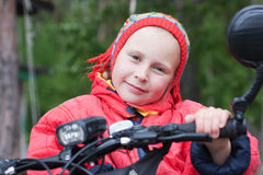 Happy girl. On a bicycle royalty free stock image