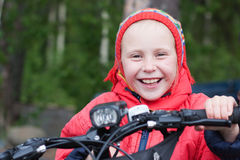 Happy girl. On a bicycle stock photo