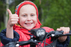 Happy girl. On a bicycle royalty free stock images
