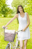 Happy girl with bicycle Stock Images