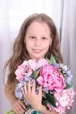 Happy girl with big beautiful bouquet of flowers Stock Images
