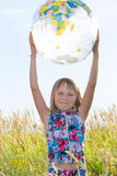 Happy girl with big globe Royalty Free Stock Photos
