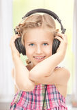 Happy girl in big headphones Royalty Free Stock Photography