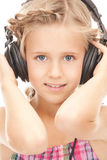 Happy girl in big headphones Stock Photo