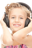 Happy girl in big headphones Royalty Free Stock Image