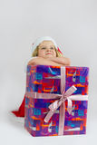 Happy girl with big new year gift Stock Photography