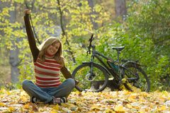 Happy girl with bike. Royalty Free Stock Photo