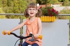 Happy girl on bike Stock Photo