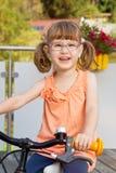 Happy girl on bike Royalty Free Stock Image