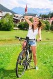 Happy girl biking in the mountains Stock Photos