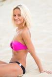 Happy girl in a bikini Stock Images