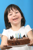 Happy girl with birthday cake Stock Photo