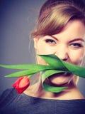 Happy girl biting flower. Stock Image