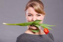Happy girl biting flower. Stock Photos