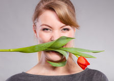 Happy girl biting flower. Stock Photo